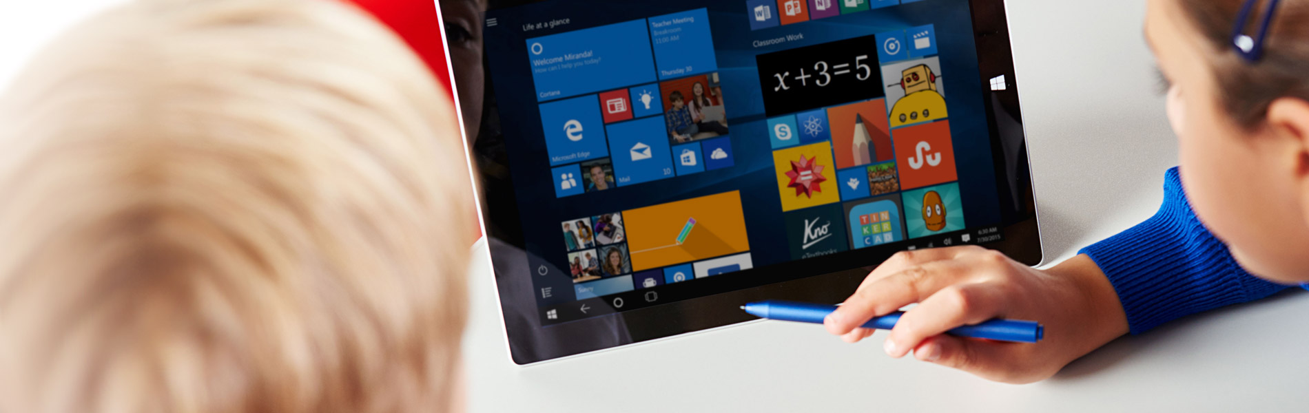 A photograph of a student using a Microsoft Surface