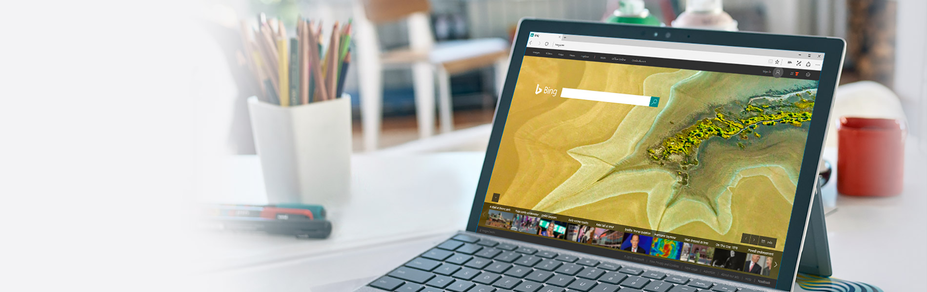 A Surface tablet on a table with the Bing search engine on the screen.