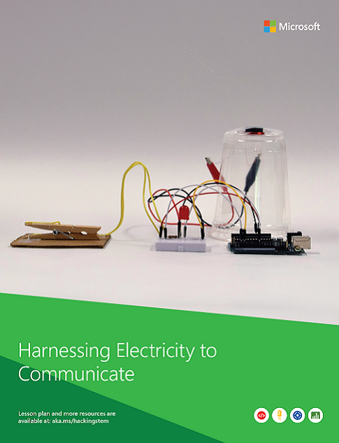 A completed Harnessing Electricity to Communicate project built from various materials such as a water cup, a clothes peg, wires, and cardboard.