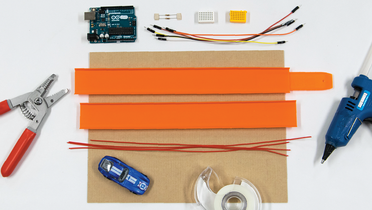 Required materials such as Hot Wheels® tracks, Hot Wheels car, wire, glue, cardboard etc.
