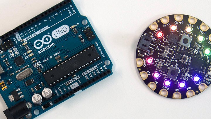 An Arduino Uno microcontroller alongside a circular LED light panel.