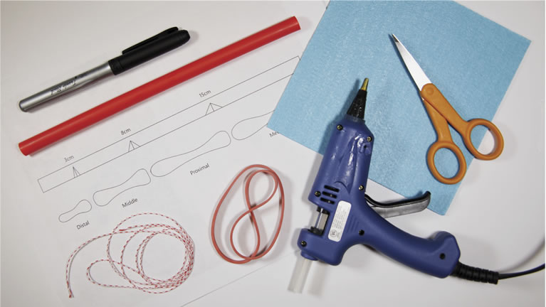 Picture of required materials such as scissors, glue gun, pen, rubber bands etc.