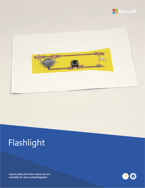 A completed flashlight project built from various materials such as copper tape, a switch and a paper clip.
