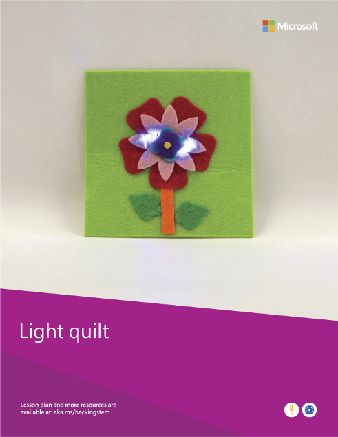 A completed light quilt project built from various materials such as felt, a coin cell battery and an LED.