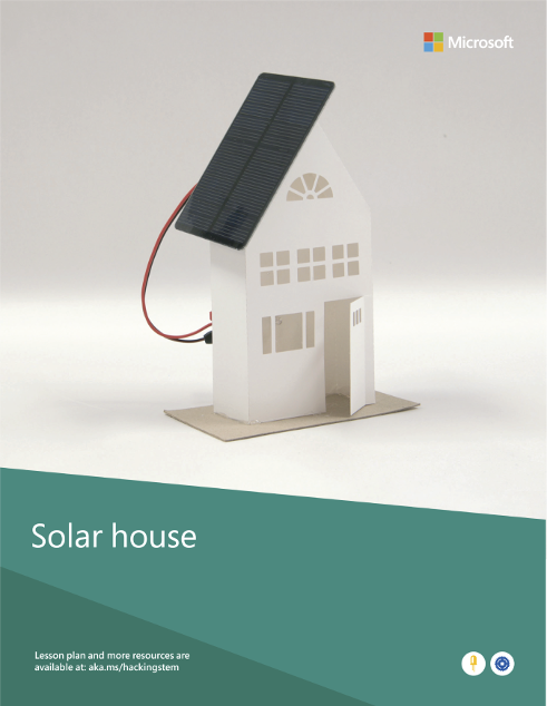 A completed solar house project built from various materials such as a solar panel, cardboard and an LED.