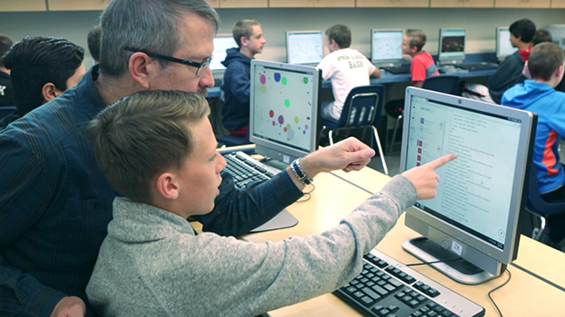 A teacher is assisting a student with a programming assignment.