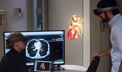 man and woman using virtual reality headset to see the human body click to open video popup