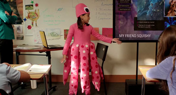 A photograph of a young girl dressed as an octopus giving a presentation to her class, created in Sway, entitled 'My Friend Squishy'.