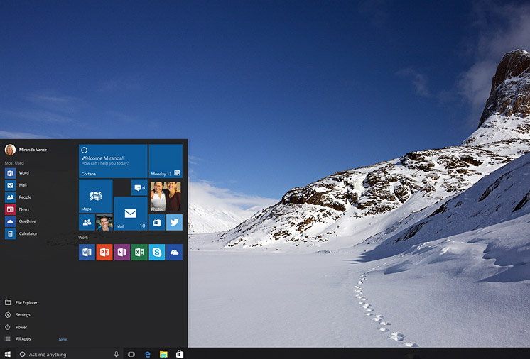 A screenshot of a Windows 10 device desktop displaying a snow-covered, mountain backdrop.