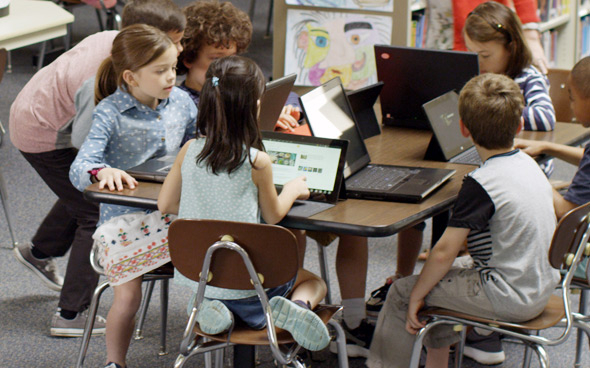 Picture of children using laptops in a classroom