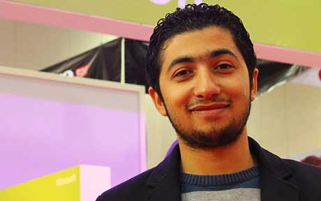 A picture of Basem Helmy. Basem is a young man with a beard, he is smiling.